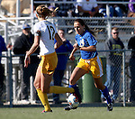 BROOKINGS, SD - OCTOBER 18: Brittany Jensen #14 from South Dakota State pushes the ball upfield against Meghan Johnston #12 from North Dakota State during their game Sunday afternoon at Fischback Soccer Field in Brookings. (Photo by Dave Eggen/Inertia)