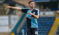 Dan Rowe of Wycombe Wanderers gives instructions during the Sky Bet League 2 match between Wycombe Wanderers and Hartlepool United at Adams Park, High Wycombe, England on 5 September 2015. Photo by Andy Rowland.