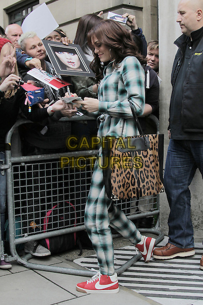 Jessie J (Jessica Ellen Cornish) leaving the studios of BBC Radio 2, London, England..September 27th, 2012.full length white grey gray black green check playsuit brown leopard print bag purse red nike trainers sneakers shoes side fans crowd signing autographs profile.CAP/HIL.©John Hillcoat/Capital Pictures.