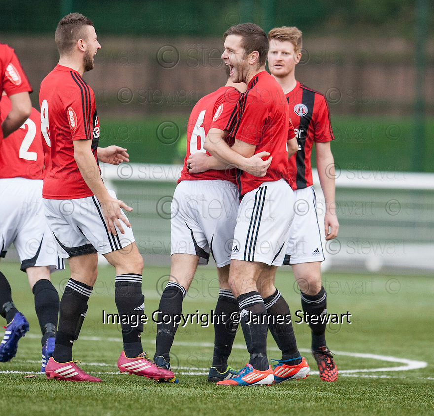 Gala's Ross Aitchison (2nd right) celebrates after he scores their first goal.