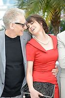 "David Cronenberg and Emily Hampshire attending the ""Cosmopolis"" Photocall during the 65th Annual Cannes International Film Festival in Cannes, France, 25.05.2012...Credit: Timm/face to face /MediaPunch Inc. ***FOR USA ONLY***"