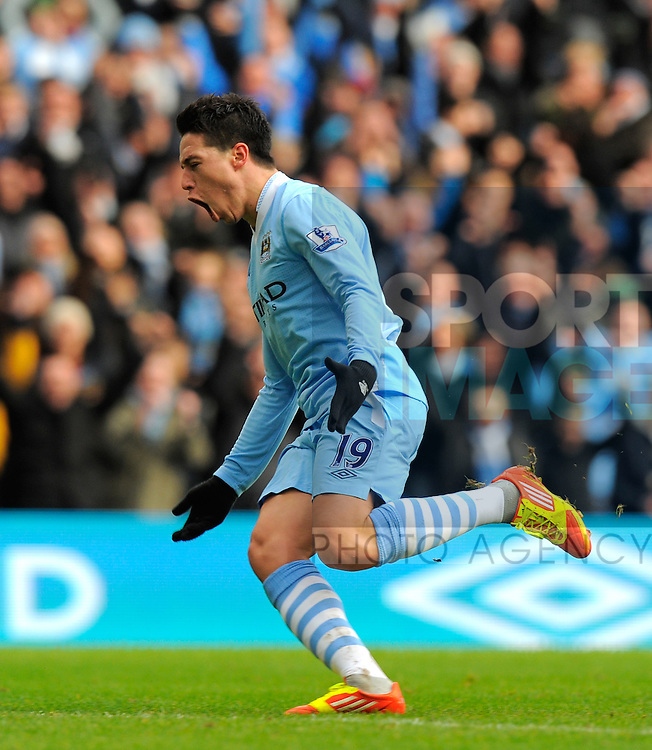 Samir Nasri of Manchester City celebrates scoring the first goal.Barclays Premier League.Manchester City v Tottenham at the Eithad Stadium, Manchester 22nd January, 2012.Sportimage +44 7980659747.picturedesk@sportimage.co.uk.http://www.sportimage.co.uk/.Editorial use only. Maximum 45 images during a match. No video emulation or promotion as 'live'. No use in games, competitions, merchandise, betting or single club/player services. No use with unofficial audio, video, data, fixtures or club/league logos.
