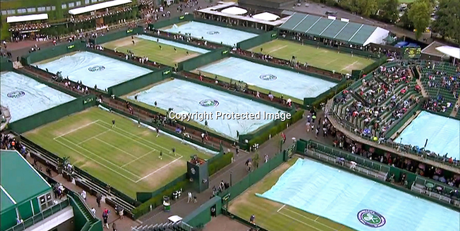 08.07.2015; Wimbledon, UK: KATE MIDDLETON AND PRINCE WILLIAM<br /> watch a rain interrupted quarter finals tennis match between Andy Murray and Vasek Pospisil at Wimbledon.<br /> The Cambridges did not look too pleased when rain stopped play.<br /> Also in attendance were Prince Albert of Monaco, Sophie, Countess of Wessex, Josh Hartnett and wife Tamsin Egerton, Billie Jean-King, David Beckham and son Romeo<br /> Mandatory Photo Credit: &copy;NEWSPIX INTERNATIONAL<br /> <br /> **ALL FEES PAYABLE TO: &quot;NEWSPIX INTERNATIONAL&quot;**<br /> <br /> PHOTO CREDIT MANDATORY!!: NEWSPIX INTERNATIONAL(Failure to credit will incur a surcharge of 100% of reproduction fees)<br /> <br /> IMMEDIATE CONFIRMATION OF USAGE REQUIRED:<br /> Newspix International, 31 Chinnery Hill, Bishop's Stortford, ENGLAND CM23 3PS<br /> Tel:+441279 324672  ; Fax: +441279656877<br /> Mobile:  0777568 1153<br /> e-mail: info@newspixinternational.co.uk
