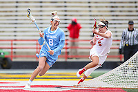 College Park, MD - February 24, 2019: North Carolina Tar Heels Katie Hoeg (8) runs pass Maryland Terrapins defender Meghan Doherty (6) during the game between North Carolina and Maryland at  Capital One Field at Maryland Stadium in College Park, MD.  (Photo by Elliott Brown/Media Images International)