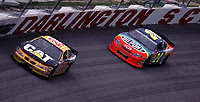 NASCAR driver Ward Burton leads Jeff Gordon early in the Mall.Com 400 at Darlington, SC Sunday, March 19 , 2000.  Burton eventually won the race, his second career Winston Cup victory.(Photo by Brian Cleary)