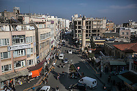 February 15, 2016: An upper view of the commercial hub in downtown Kilis, where thousands of Syrian refugees crowd the streets. During the ongoing war in the neighbouring country the bordertown of Kilis has rised its populaiton to the double due the influx of refugees fleeing the the war-torn country.