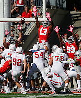 From left, Ohio State Buckeyes defensive end Sam Hubbard (6), defensive end Rashod Berry (13) and defensive lineman Tyquan Lewis (59) leap as Indiana Hoosiers place kicker Griffin Oakes (92) makes a field goal to go up 3-0 during the first quarter of the NCAA football game at Ohio Stadium in Columbus on Oct. 8, 2016. (Adam Cairns / The Columbus Dispatch)