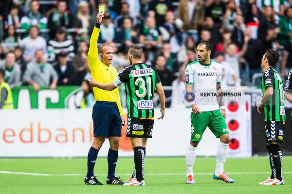 Stockholm 2014-06-18 Fotboll Superettan Hammarby IF - GAIS :  <br /> GAIS Shkelqim Krasniqi f&aring;r en varning av domare Patrik Eriksson efter att ha jublat mot Hammarbys supportrar efter sitt 1-0 m&aring;l<br /> (Foto: Kenta J&ouml;nsson) Nyckelord:  Superettan Tele2 Arena Hammarby HIF Bajen GAIS varning gult kort