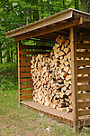 Outdoor firewood structure.