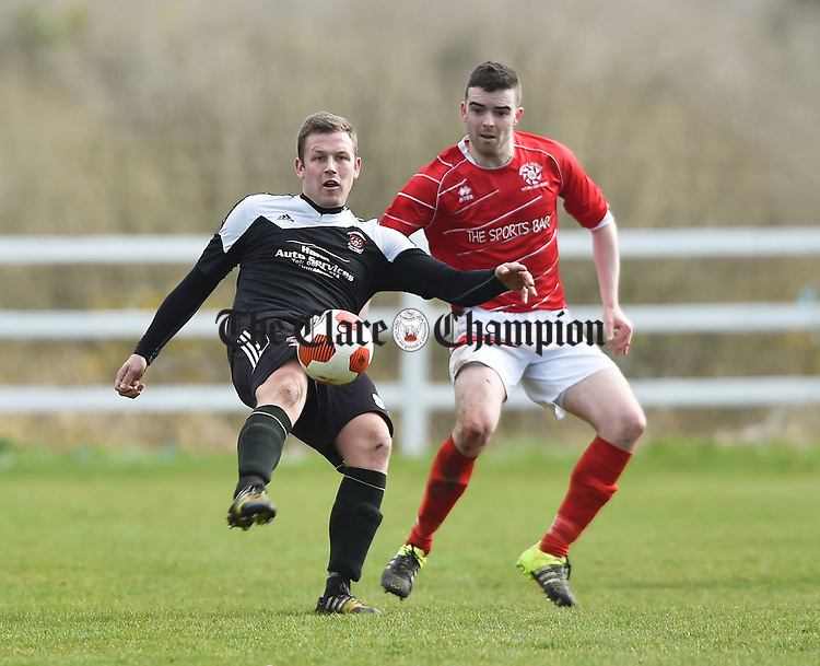 Shane Clarke of Janesboro in action against David O Grady of Newmarket Celtic during their Munster League Champions Trophy final at The County Grounds, Doora. Photograph by John Kelly.