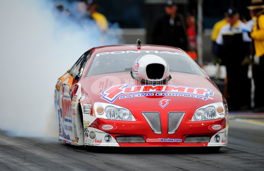 Sept. 16, 2011; Concord, NC, USA: NHRA pro stock  driver Greg Anderson during qualifying for the O'Reilly Auto Parts Nationals at zMax Dragway. Mandatory Credit: Mark J. Rebilas-US PRESSWIRE