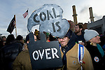Kevin Buckland, environmental activist and art co-ordinator displays his sign in front of the Capitol Coal plant. On March 2, 2009, thousands of protestors marched on the Capitol Coal Plant in Washington, D.C. The protestors were calling for clean renewable energy future. Two days before the planned protest, the US government announced that the plant would be converted to Natural Gas. Organizers cited this news as a partial, but incomplete victory - as Natural Gas is still a fossil fuel - and vowed to take on coal plants across the country.  (©Robert vanWaarden)