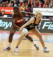 31.10.2013 Silver Fern Shannon Francois and Malawi's Joanna Kachilika in action during the Silver Ferns V Malawi during the New World Netball Series played at the Claudelands Arena in Hamilton. Mandatory Photo Credit ©Michael Bradley.