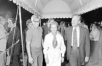 Surrounded by Secret Service agents and the press at the South Portico of the White House, the President and Mrs. Ford , with their son Steve, at around 10:52 pm[1] on September 5, 1975, return home following the 10:04 am attempt on the President's life in Sacramento, California earlier that day.