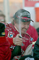 Bill Elliott celebrates with champagne in victory lane after winning the Pop Secret 400 NASCAR Winston Cup race at Rockingham, NC on Sunday, November 9, 2003. (Photo by Brian Cleary)