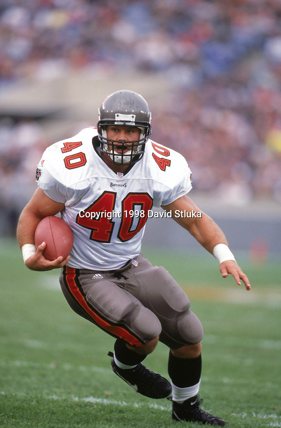 Tampa Bay Buccaneers full back Mike Alstott (40) carries the ball during an NFL football game against the Chicago Bears at Soldier Field on November 29, 1998 in Chicago, Illinois. The Buccaneers won 31-17. (Photo by David Stluka)