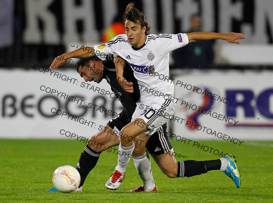 BELGRADE, SERBIA - SEPTEMBER 20. Lazar Markovic (R) of Partizan is challenged by Mahir Shukurov of Azerbaijan's Neftchi PFK during the UEFA Europa League Group H match between FC Partizan and FC Neftci at Partizan stadium in Belgrade, Serbia on Thursday, September 20, 2012. (Photo by Srdjan Stevanovic/Getty Images)