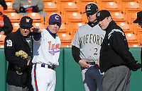 Head coach Jack Leggett  of the Clemson Tigers and Todd Interdonato of the Wofford Terriers meet with the umpires prior to a game on Wednesday, March 6, 2013, at Doug Kingsmore Stadium in Clemson, South Carolina. Clemson won, 9-2. (Tom Priddy/Four Seam Images)