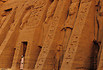 Colossal statues of Ramses II and Nefertari on the exterior of Nefertari's temple at Abu Simbel, Egypt