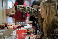 NWA Democrat-Gazette/CHARLIE KAIJO Stephany Melo, 9, of Bentonville picks out a cupcake during a cupcake fundraiser, Sunday, February 10, 2019 at the First United Methodist Church in Bentonville. <br />