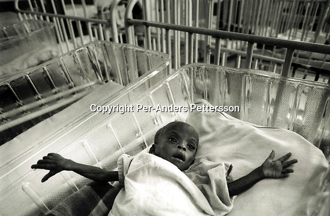MURCHISON, SOUTH AFRICA - OCTOBER 21: An unidentified baby orphan infected by HIV-Aids in the children's ward on October 21, 1999 at Murchison hospital in Southern Natal, South Africa. Many babies and children are abandoned by their parents and left at the hospital gate.  Its estimated that about one thousand South African's are infected a day and that about five million of the population are infected. .Photo: Per-Anders Pettersson/ iAfrika Photos......