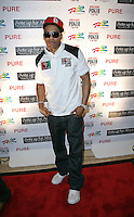 NELLY (Cornell Haynes, Jr.).The Ante Up for Africa Celebrity Poker Tournament at the Rio Resort Hotel and Casino, Las Vegas, Nevada, USA..July 2nd, 2009.full length jeans denim black white top red baseball cap hat sunglasses shades .CAP/ADM/MJT.© MJT/AdMedia/Capital Pictures