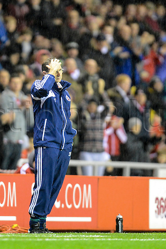 27.11.2012 Sunderland, England. Martin O'Neill moops his head in rain during the Premier League game between Sunderland and Queens Park Rangers at the Stadium of Light.