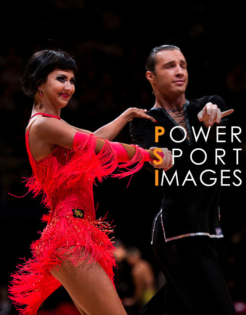 Nikolay Mikadze and Yana Novikova of Russia during the WDSF GrandSlam Latin on the Day 1 of the WDSF GrandSlam Hong Kong 2014 on May 31, 2014 at the Queen Elizabeth Stadium Arena in Hong Kong, China. Photo by AItor Alcalde / Power Sport Images
