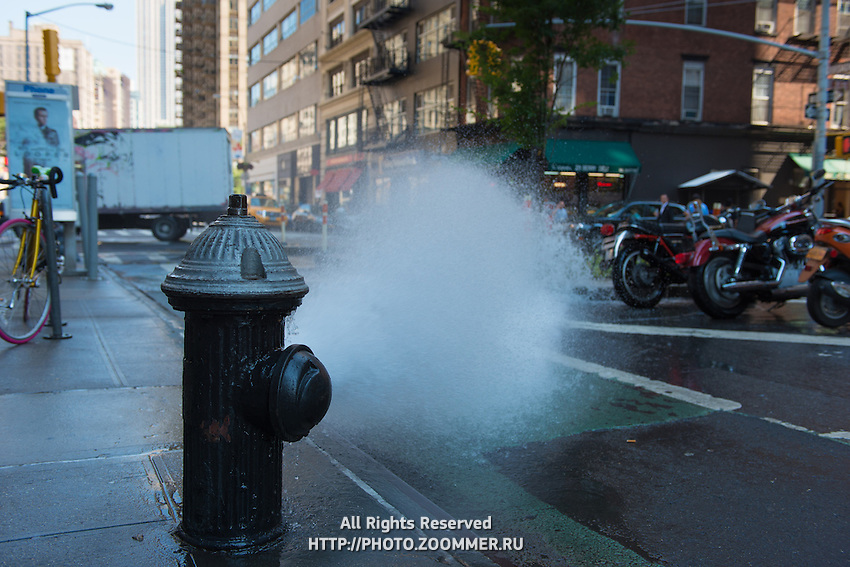 Spray of water from  broken johnny pump on Manhattan, New York