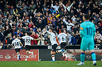 25th January 2020; Mestalla, Valencia, Spain; La Liga Football,Valencia versus Barcelona; Maxi Gomez of Valencia CF celebrates with his team mates watched by Lionel Messi of FCB, after scoring in minute 77' the second goal for his team (2-0)
