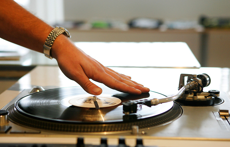 February 19, 2008; Santa Cruz, CA, USA; A DJ spins vinyl records on a turntable in Santa Cruz, CA. Photo by: Phillip Carter
