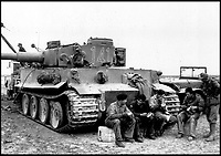 BNPS.co.uk (01202 558833)Pic:    Pen&Sword/BNPS<br /> <br /> Crew are seen eating their rations following the installation of an engine on a Tiger tank.<br /> <br /> Fascinating rare photos of Rommel's feared Afrika Korps which terrorised the Allies in the desert have come to light in a new book.<br /> <br /> Under the direction of legendary German commander Field Marshal Erwin Rommel, who was nicknamed the Desert Fox, the corps were recognised as a superb fighting machine.<br /> <br /> They achieved their greatest triumph when they outmanoeuvred the British at the Battle of Gazala in June 1942 which led to them capturing Tobruk in Libya.<br /> <br /> But they were ultimately defeated in the iconic Battle of Alamein when they succumbed to an offensive led by Field Marshal Bernard Montgomery.