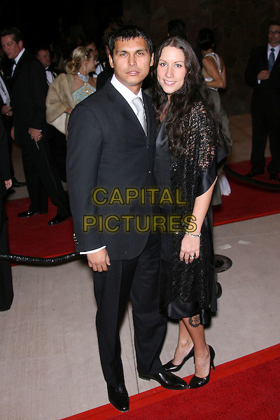 ADAM BEACH & GUEST.18th Annual Palm Springs International Film Festival Hosts Star-Studded Awards Gala held at the Palm Springs Convention Center, Palm Springs, California, USA,.6 January 2007..full length.CAP/ADM/ZL.©Zach Lipp/Admedia/Capital Pictures