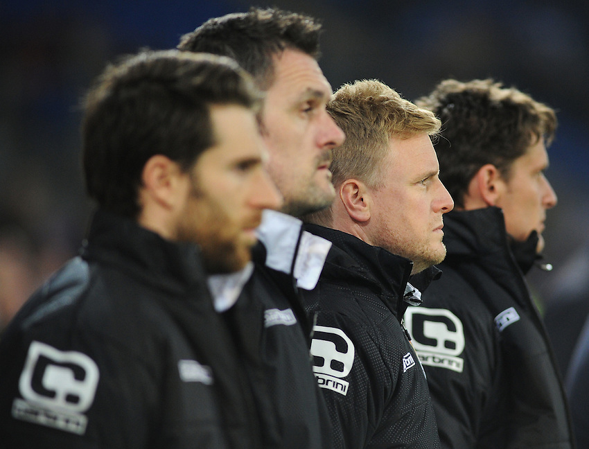 Bournemouth manager Eddie Howe (second right) observes a minutes silence as Cardiff City pay tribute to the victims of a recent road traffic accident in South Wales<br /> <br /> Photographer Kevin Barnes/CameraSport<br /> <br /> Football - The Football League Sky Bet Championship - Cardiff v Bournemouth - Tuesday 17th March 2015 - Cardiff City Stadium - Cardiff<br /> <br /> &copy; CameraSport - 43 Linden Ave. Countesthorpe. Leicester. England. LE8 5PG - Tel: +44 (0) 116 277 4147 - admin@camerasport.com - www.camerasport.com