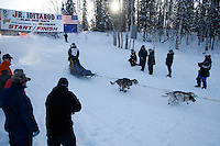 Sunday February 27, 2010   Merissa Osmar leaves the start line of the Junior Iditarod at Willow Lake, Alaska