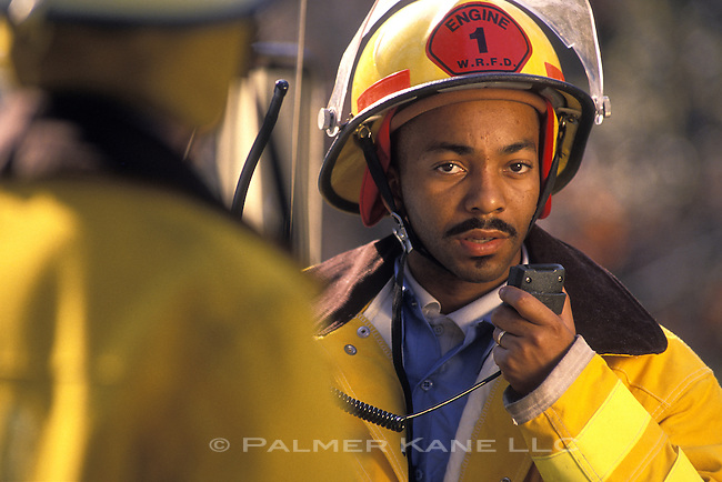 African American fire fighter using radio