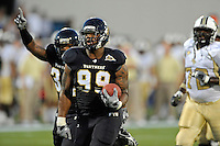 17 September 2011:  FIU defensive line Isame Faciane (99) returns a fumble recovery for a touchdown at the end of the first half to tie the game as the FIU Golden Panthers defeated the University of Central Florida Golden Knights, 17-10, at FIU Stadium in Miami, Florida.