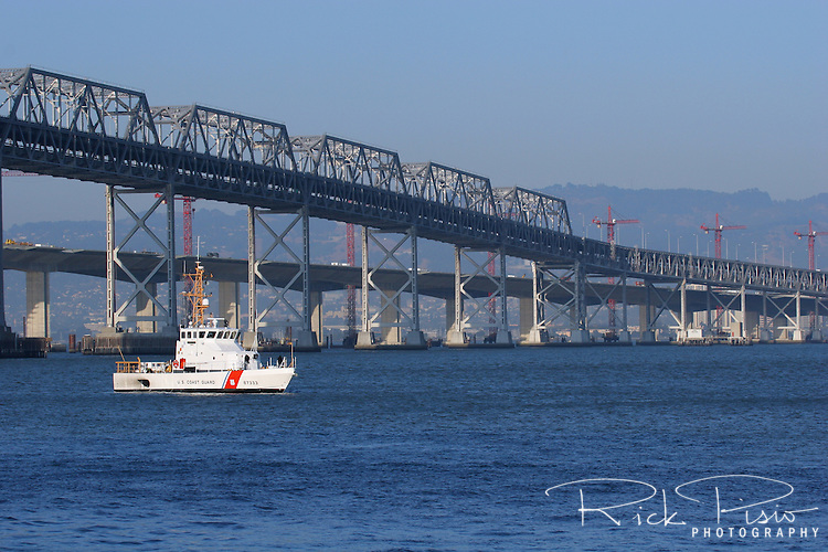The 87 foot United States Coast Guard Cutter Adelie patrols the waters below the eastern span of the Bay Bridge on San Francisco Bay. The Adelie is a Marine Protector Class Cutter based in Port Angeles, Washington, and was in the waters of San Francisco Bay as part of the Coast Guard resources assigned to the 2006 San Francisco Fleet Week Activities.