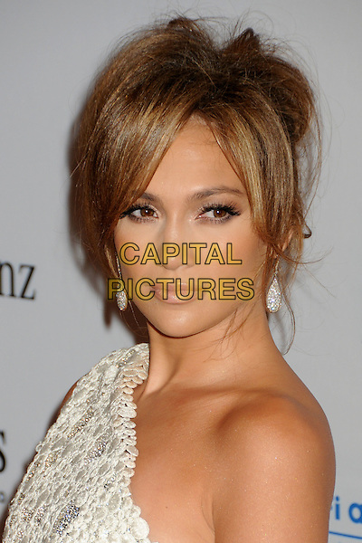 JENNIFER LOPEZ .32nd Anniversay Carousel of Hope Gala held at the Beverly Hilton Hotel, Beverly Hills, California, USA, .23rd October 2010..portrait headshot white one shoulder hair up earrings beauty make-up dangly cream lace jlo.CAP/ADM/BP.©Byron Purvis/AdMedia/Capital Pictures.