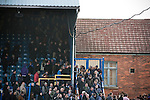 "Portsmouth fans making their way out of Fratton Park stadium after their team's match against local rivals Southampton in a Championship fixture. Around 3000 away fans were taken directly to the game in a fleet of buses in a police operation known as the ""coach bubble"" to avoid the possibility of disorder between rival fans. The match ended in a one-all draw watched by a near capacity crowd of 19,879."