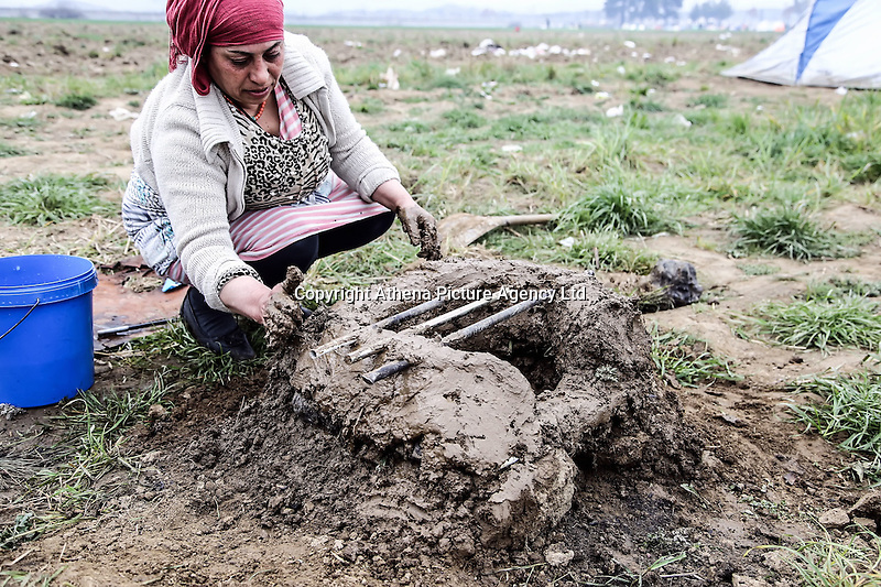 Pictured: A woman makes a barbecue out of clay to use it for cooking food Monday 07 March 2016<br />