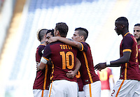 Calcio, Serie A: Roma vs Sassuolo. Roma, stadio Olimpico, 20 settembre 2015.<br /> Roma&rsquo;s Mohamed Salah, second from left, celebrates with teammates after scoring during the Italian Serie A football match between Roma and Sassuolo at Rome's Olympic stadium, 20 September 2015.<br /> UPDATE IMAGES PRESS/Isabella Bonotto