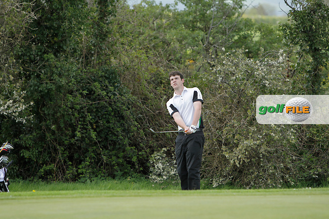 Kyle McCarron (North West) chipping onto the 14th green during Day 1 of The Munster Youths' Amateur Open Championship in Dungarvan Golf Club on Wednesday 23nd April 2014.<br /> Picture:  Thos Caffrey / www.golffile.ie