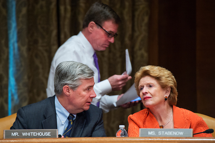 "UNITED STATES - JUNE 17: From left, Sens. Sheldon Whitehouse, D-R.I., Mark Warner, D-Va., and Debbie Stabenow, D-Mich., attend a Senate Budget Committee hearing in Dirksen Building titled ""Congressional Budget Office's Long Term Fiscal Outlook for Nation,"" June 17, 2015. CBO Director Keith Hall testified. (Photo By Tom Williams/CQ Roll Call)"