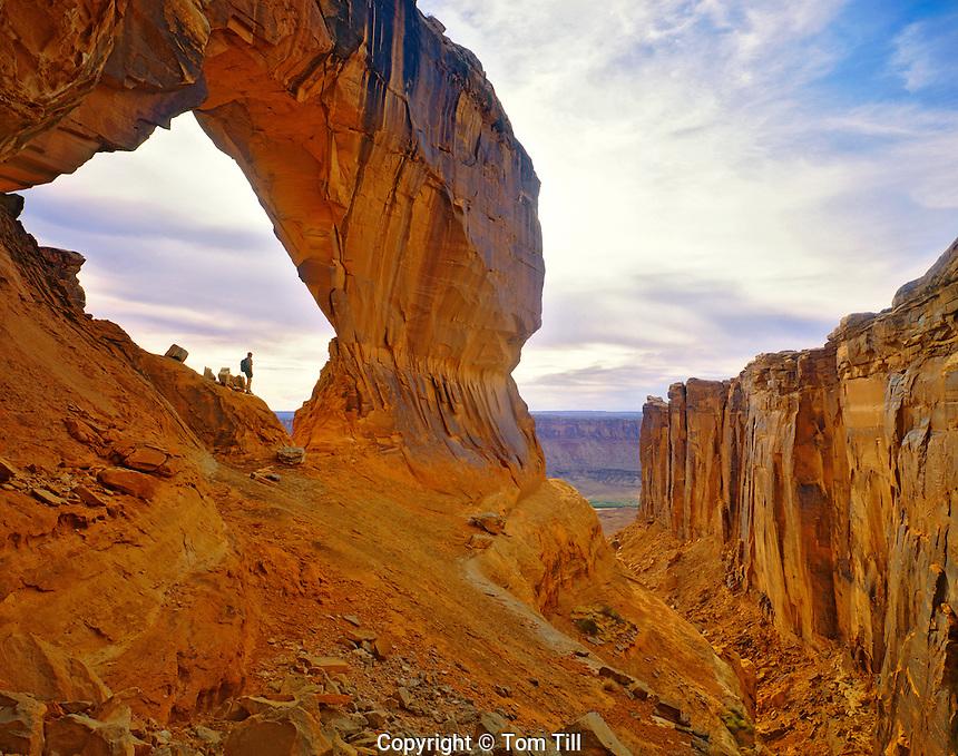 Hiker in Natural Arch, Canyonlands National Park, Utah
