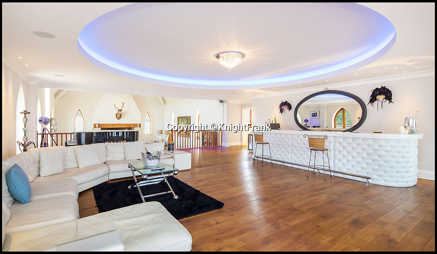 BNPS.co.uk (01202 558833)<br /> Pic:  KnightFrank/BNPS<br /> <br /> Bar area and dancefloor...<br /> <br /> A stunning new Arts and Crafts style country manor which comes with its own lake, swimming pool, tennis court and summer house has come on to the market for £4.95million.<br /> <br /> Recently built Thakeham Manor, which also has a helipad, is set in 16 acres of landscaped parkland near Pulborough, West Sussex.<br /> <br /> Its eye-catching design, inspired by the famous early 20th century architect Edwin Lutyens, includes a slate roof, stone quoins and brick buttresses, while inside it is full of glamorous modern touches.<br /> <br /> The luxurious property has five bedrooms, five bathrooms and six reception rooms, and its grounds contain a heated swimming pool and decking area, a circular cushioned seating area and a tennis court.