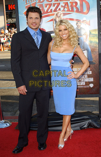 "NICK LACHEY & JESSICA SIMPSON.The Warner Brothers World Premiere of ""The Dukes of Hazzard"" held at The Grauman's Chinese Theatre in Hollywood, California  .July 28th, 2005.full length celebrity couple married husband wife blue dress hand on hip  blue pinstripe suit.www.capitalpictures.com.sales@capitalpictures.com.Supplied By Capital PIctures"