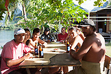 FRENCH POLYNESIA, Moorea. Portrait of a family sitting at an outside table.