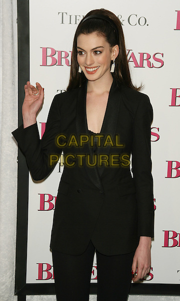 "ANNE HATHAWAY.New York Premiere of ""Bride Wars"".at the AMC Loews Lincoln Square Cinemas, New York, NY, USA..January 5th, 2009.half length black jacket suit dangling earrings hair band hairband dangling white earrings hand waving .CAP/LNC/TOM.©TOM/LNC/Capital Pictures."