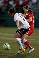 Abby Wambach (20) of the magicJack and Brittany Bock (21) of the Western New York Flash battle for control in the second half.  The Western New York Flash defeated the magicJack 3-0 in Women's Professional Soccer (WPS) at Sahlen's Stadium in Rochester, NY May 22, 2011.